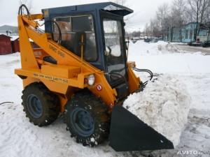 погрузчик unc 060 очистка снега
