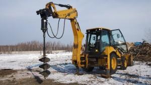 caterpillar 428  с навесным оборудованиям