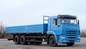 Современный бортовой тягач КамАЗ 65117